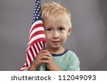 a cute young boy holds an... | Shutterstock . vector #112049093