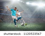 soccer players on a football... | Shutterstock . vector #1120523567