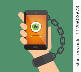 hand chained to the smart phone ... | Shutterstock .eps vector #1120603673