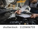 hand of young man mechanic... | Shutterstock . vector #1120606733