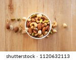 mixed nuts in white ceramic...   Shutterstock . vector #1120632113