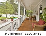 upscale porch with furniture - stock photo