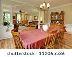 tasteful dining and livingroom with wood furniture - stock photo