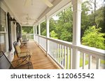 upscale front second story porch - stock photo