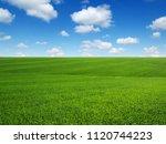 green grass field on hills and... | Shutterstock . vector #1120744223