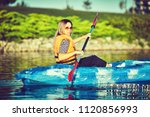kayaking and canoeing with... | Shutterstock . vector #1120856993