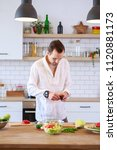 Small photo of Image of brunet cooking dinner on table