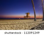 Night scene as sunsets on Southern California beach - stock photo