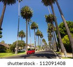 BEVERLY HILLS, CA - AUG 10:  Palm tree lined street in Beverly Hills, Ca on Aug. 10, 2012. Beverly Hills is world-famous for its luxurious culture and famous residents. - stock photo