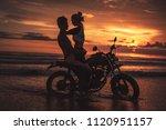 seductive couple hugging on... | Shutterstock . vector #1120951157