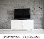 modern flat lcd television set... | Shutterstock . vector #1121028233