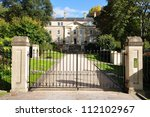 Gate and Driveway of a Georgian Era English Country Mansion - stock photo