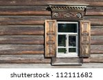Window with casings in an old wooden house made ??of logs - stock photo