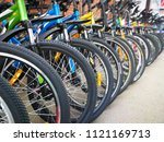 bicycle shop  rows of new bikes | Shutterstock . vector #1121169713