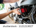 man hands changing the air... | Shutterstock . vector #1121213027