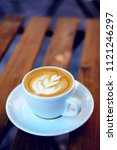 cup of cappuccino on the table. ... | Shutterstock . vector #1121246297