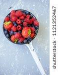 organic fresh harvested berries.... | Shutterstock . vector #1121352467