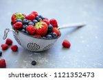 organic fresh harvested berries.... | Shutterstock . vector #1121352473