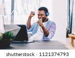 emotional dark skinned male... | Shutterstock . vector #1121374793
