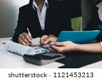 business people analyzing... | Shutterstock . vector #1121453213