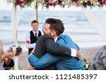 two men hugging at wedding... | Shutterstock . vector #1121485397
