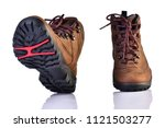 pair of brown hiking boots ... | Shutterstock . vector #1121503277