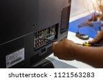 young technician repairing a... | Shutterstock . vector #1121563283