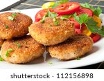 chicken cutlets with vegetables and herbs - stock photo