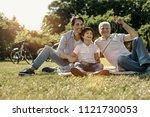 relaxing together. happy... | Shutterstock . vector #1121730053