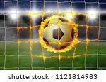 burning football lands in the... | Shutterstock . vector #1121814983
