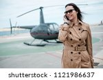 business woman near private... | Shutterstock . vector #1121986637