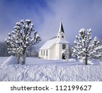 Winter landscape with countryside church - stock photo