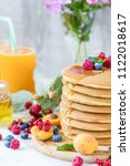 fresh delicious pancakes with... | Shutterstock . vector #1122018617