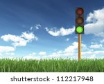 Green Traffic Light against Blue Sky Background - stock photo