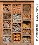 Small photo of frontal closeup of a insect hotel in sunny ambiance