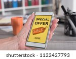 female hand holding a... | Shutterstock . vector #1122427793