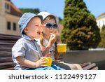 happy brother and sister... | Shutterstock . vector #1122499127