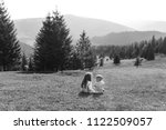 sister and brother sitting on... | Shutterstock . vector #1122509057