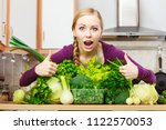woman in kitchen with many... | Shutterstock . vector #1122570053