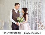 bride and groom hug and pose... | Shutterstock . vector #1122701027