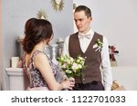bride and groom hug and pose... | Shutterstock . vector #1122701033