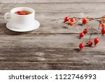 berries of dogrose and tea on... | Shutterstock . vector #1122746993