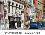 MANCHESTER, ENGLAND - MAY 25: Faulkner Street in Chinatown on May 25, 2012 in Manchester, England. Manchester's Chinatown is the 2nd largest Chinatown in the UK and the 3rd largest in Europe. - stock photo