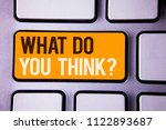 Small photo of Conceptual hand writing showing What Do You Think Question. Business photo text Opinion Sentiments Comment Judgment Conviction Gray color polished keyboard with yellow button black white text.