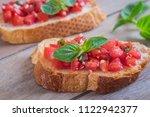 bruschetta with chopped tomato... | Shutterstock . vector #1122942377
