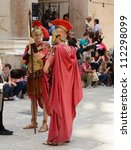 SPLIT, CROATIA - MAY 27: men dress as Roman soldiers for tourists on May 27, 2012 in the Old Town of Split, Croatia. Split's Old Town is a UNESCO World Heritage Site. - stock photo