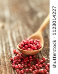 red peppercorns  in a spoon on...   Shutterstock . vector #1123014227