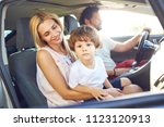 the family travels in the car... | Shutterstock . vector #1123120913