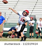 CUMMING, GA/USA - SEPTEMBER 8: Unidentified boy throwing a pass during a football game. A team of 7th grade boys September 8, 2012 in Cumming GA. The Wildcats  vs The Mustangs. - stock photo