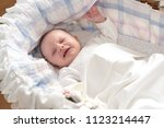 little baby girl crying in her... | Shutterstock . vector #1123214447